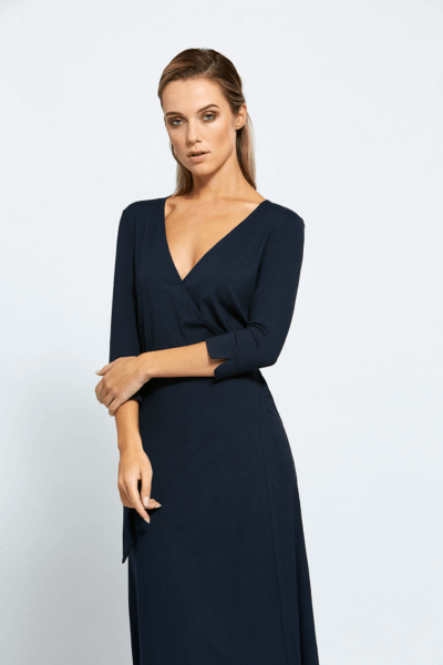maie navy blue dress by a blonde woman